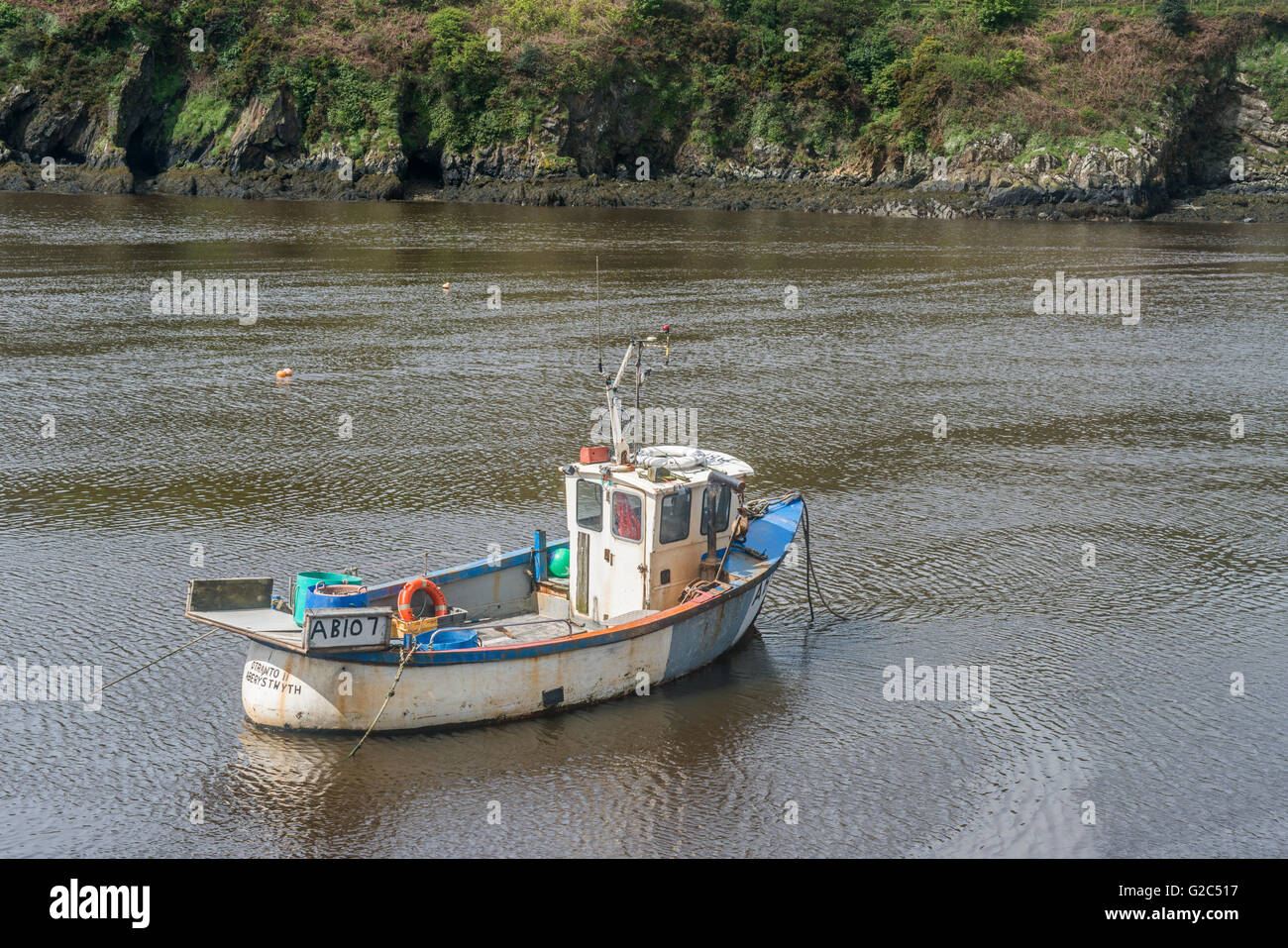 Fishing Boat moored in Lower Fishguard Harbour in Pembrokeshire - Stock Image