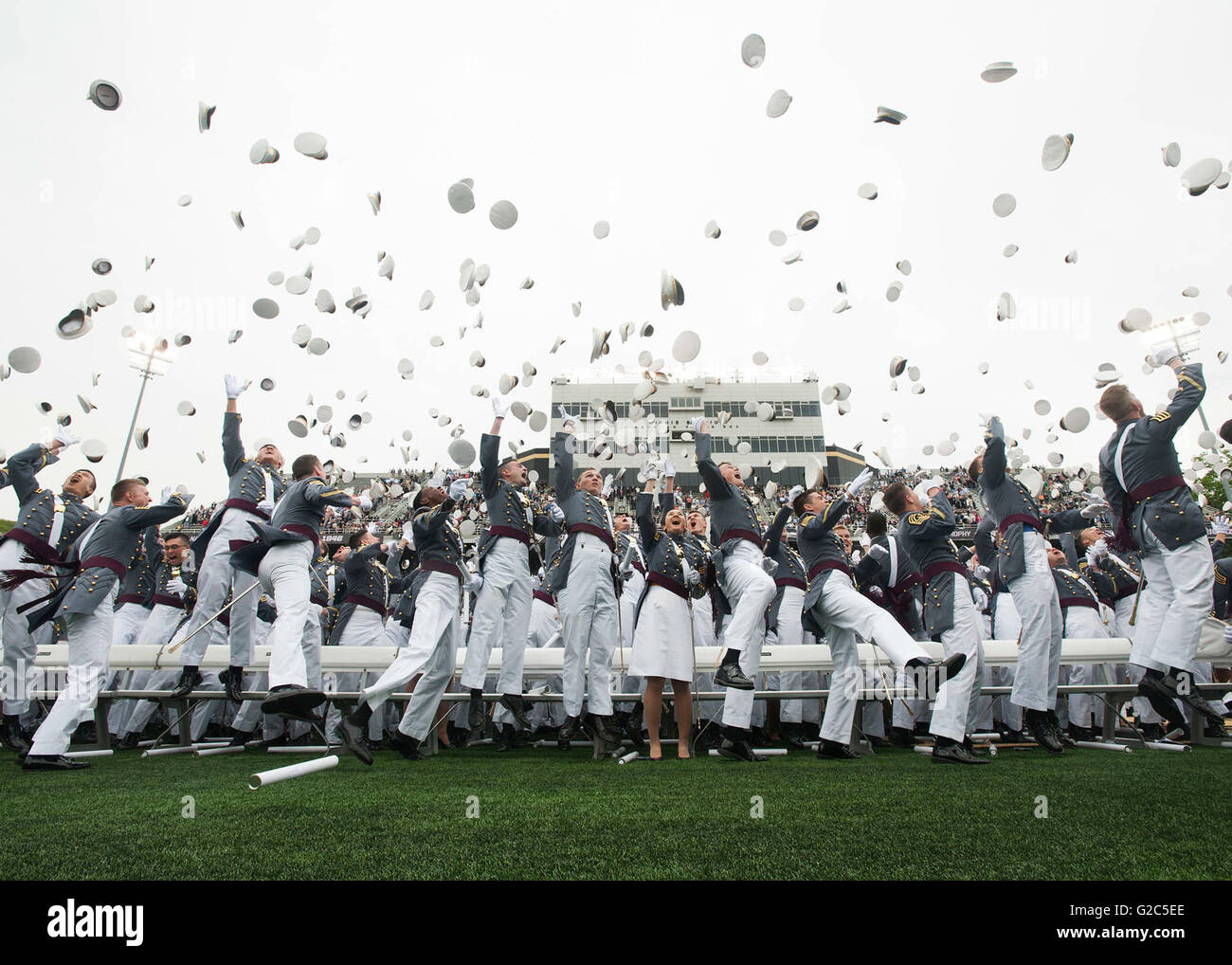 U.S Army cadets celebrate by throwing their hats into the air at the  commencement ceremony for d5798e653824