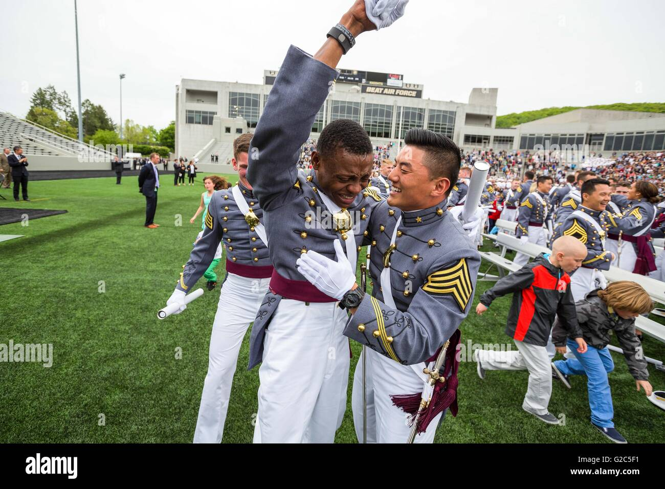 Tears stream down the face of West Point Cadet Alix Idrache as he is embraced by his friends during the 2016 commencement Stock Photo