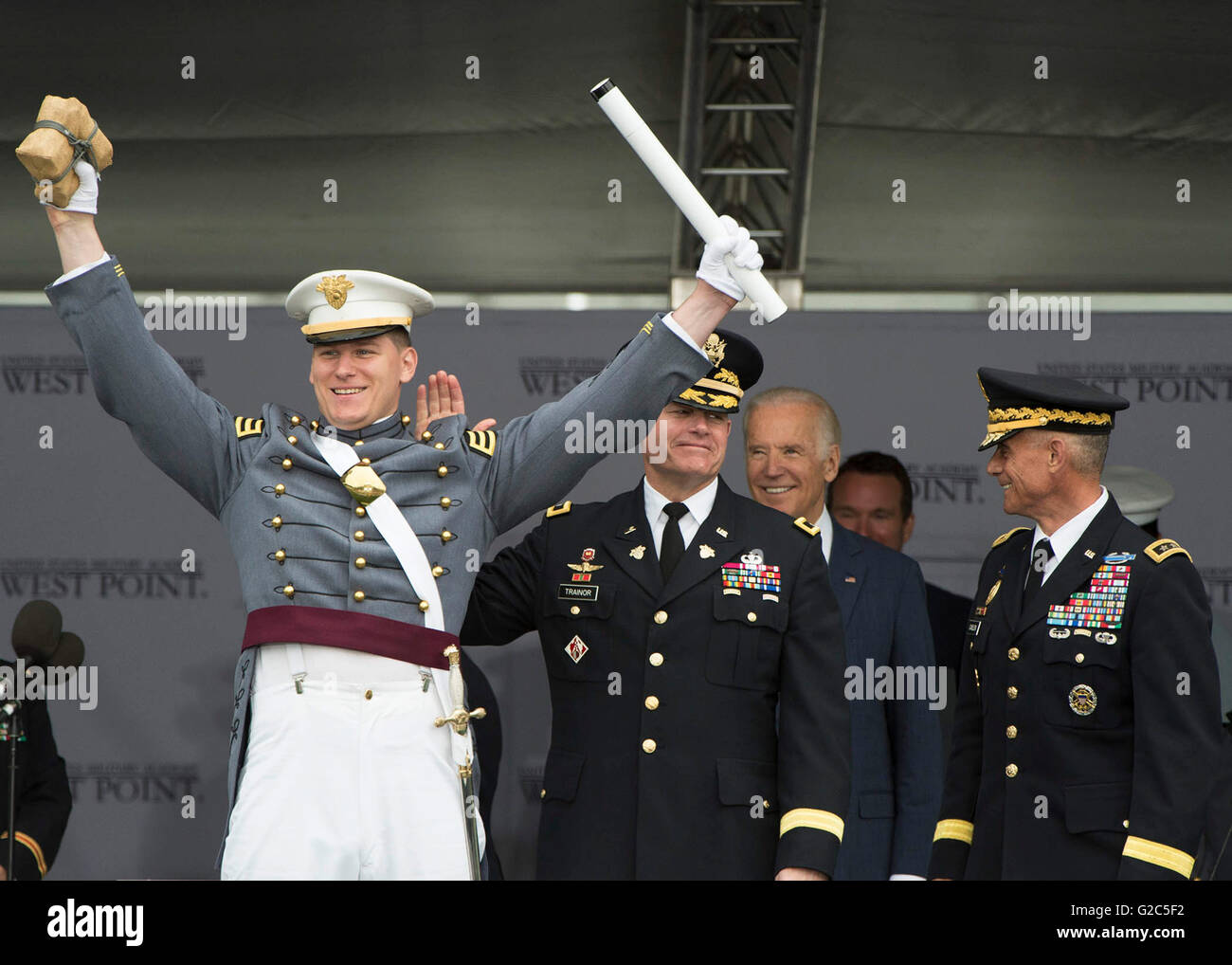 U.S. Vice President Joe Biden smiles as Army Cadet Alex Fletcher celebrates being named the Goat of the U.S. Military - Stock Image