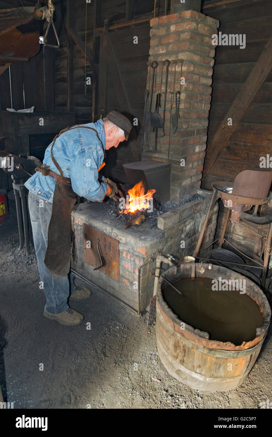 California, Coloma, Marshall Gold Discovery State Historic Park, blacksmith working at forge - Stock Image