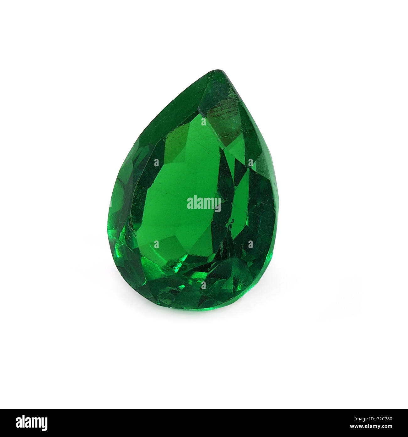Emerald pear shaped on a white background. - Stock Image