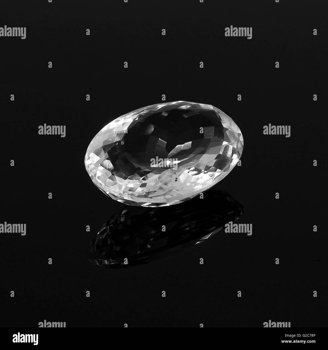 White topaz on a black background. Diamond on awhite background. - Stock Image