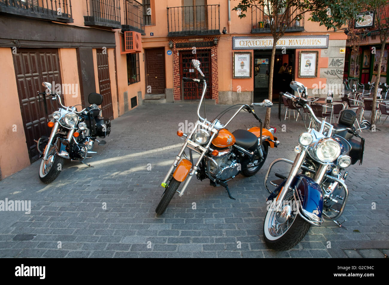 Three motorcycles. Puerta Cerrada square, Madrid, Spain. - Stock Image