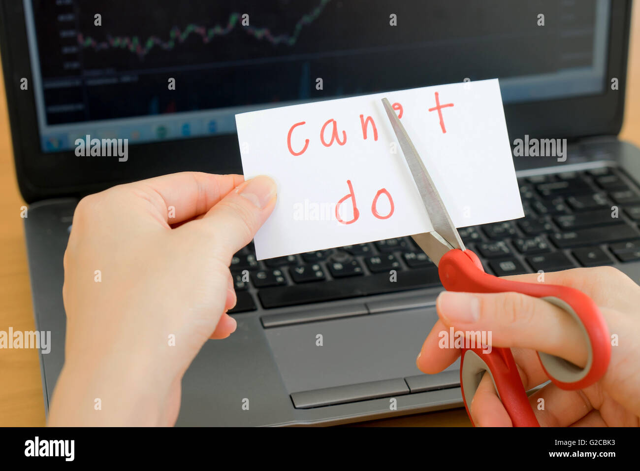holds card with text can't do on computer - Stock Image