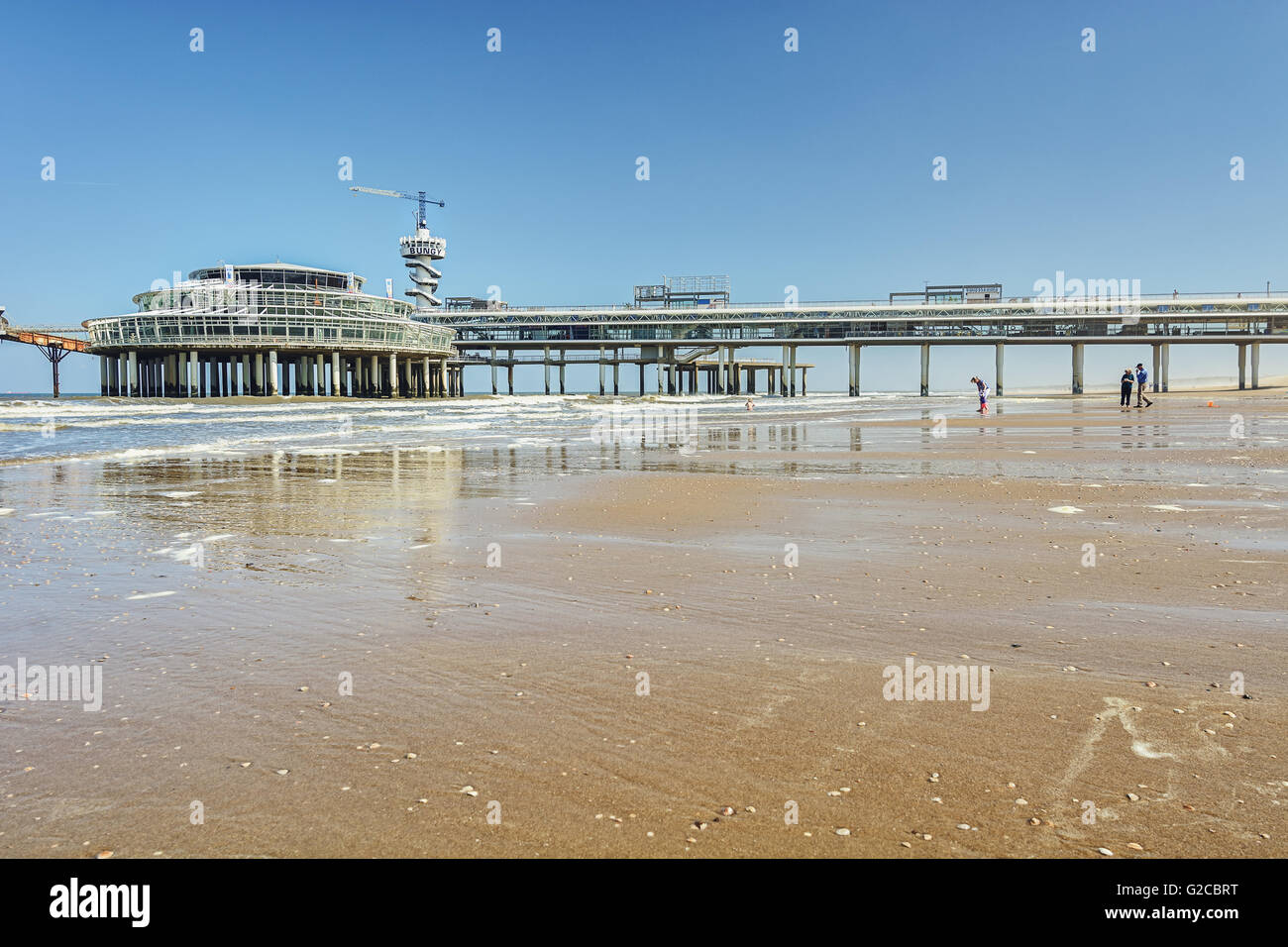 View from the beach to the pier with bungee jumping in Scheveningen, Netherlands. Stock Photo