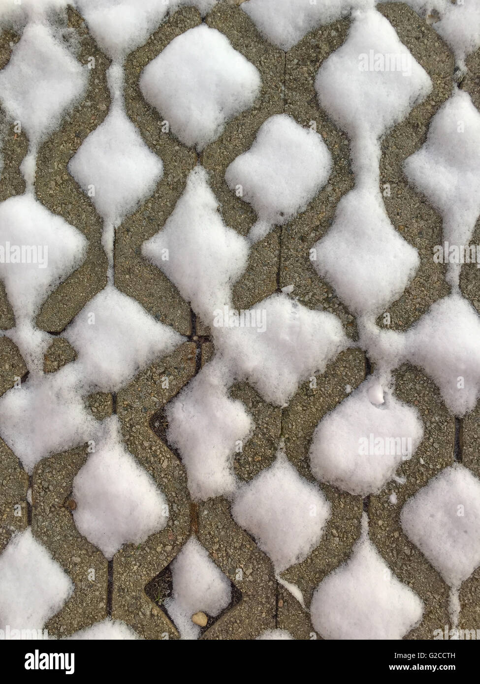 snow collected within the empty cavities of concrete bricks - Stock Image