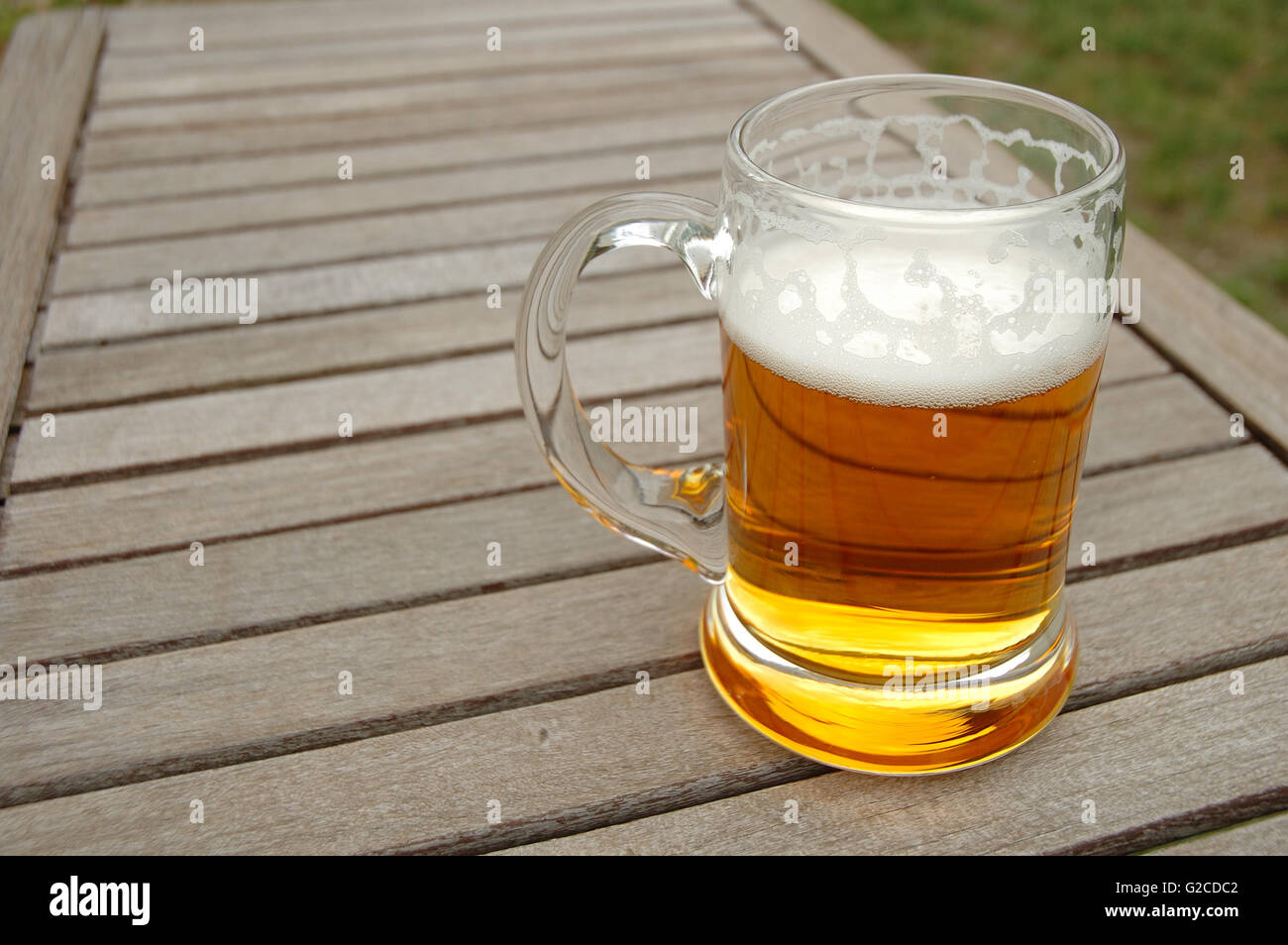 Beer mug on wooden table outdoors - Stock Image