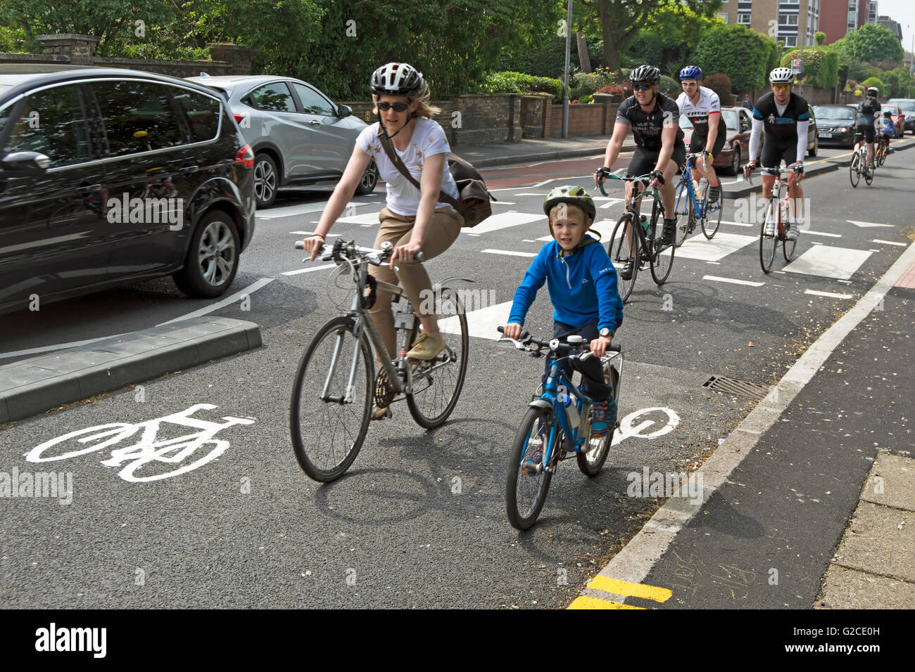 cyclists using a segregated  two-way cycle lane in kingston upon thames, surrey, england - Stock Image