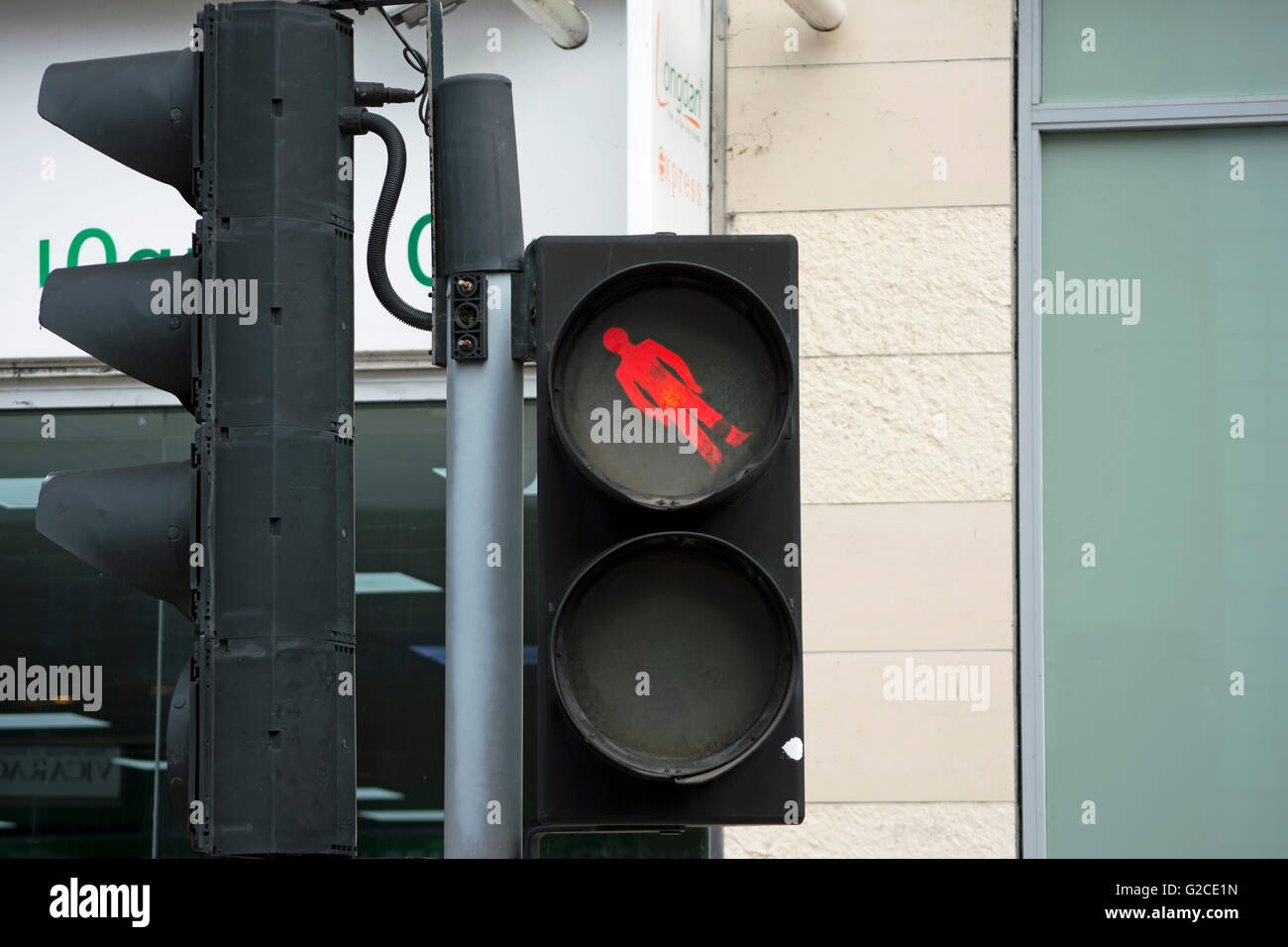 british pelican crossing with pictogram of red man at unusual angle, kingston upon thames, surrey, england - Stock Image