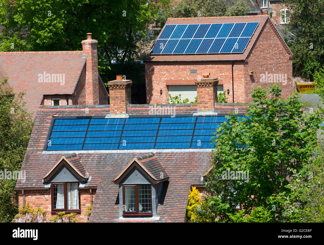 Photovoltaic panels on buildings in Cleobury Mortimer, Shropshire, England, UK. - Stock Image