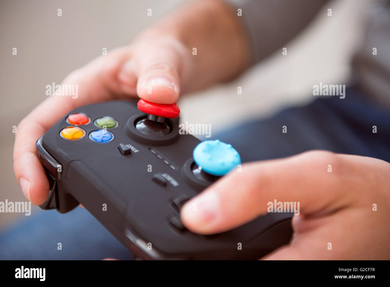 Man playing and holding joystick - Stock Image