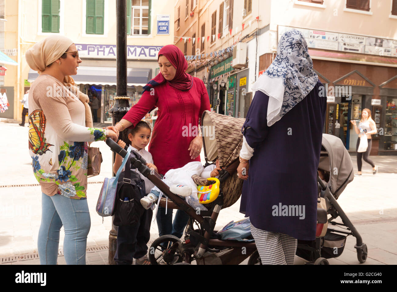 Muslim family in Main Street, Gibraltar, Europe. Concept of European Immigration Stock Photo