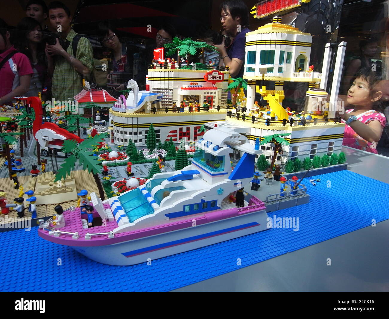Lego Model building  toy fun landscape city river yacht shopping mall people garden - Stock Image
