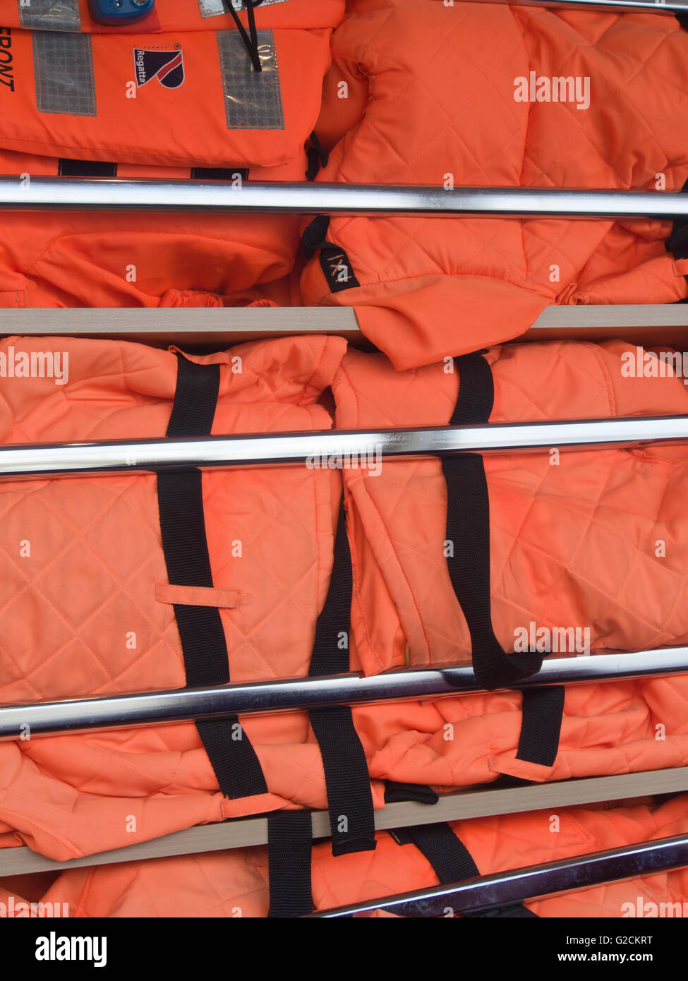 Stack of life vests on board a passenger ferry on the Oslo fjord for easy access in case of an emergency - Stock Image