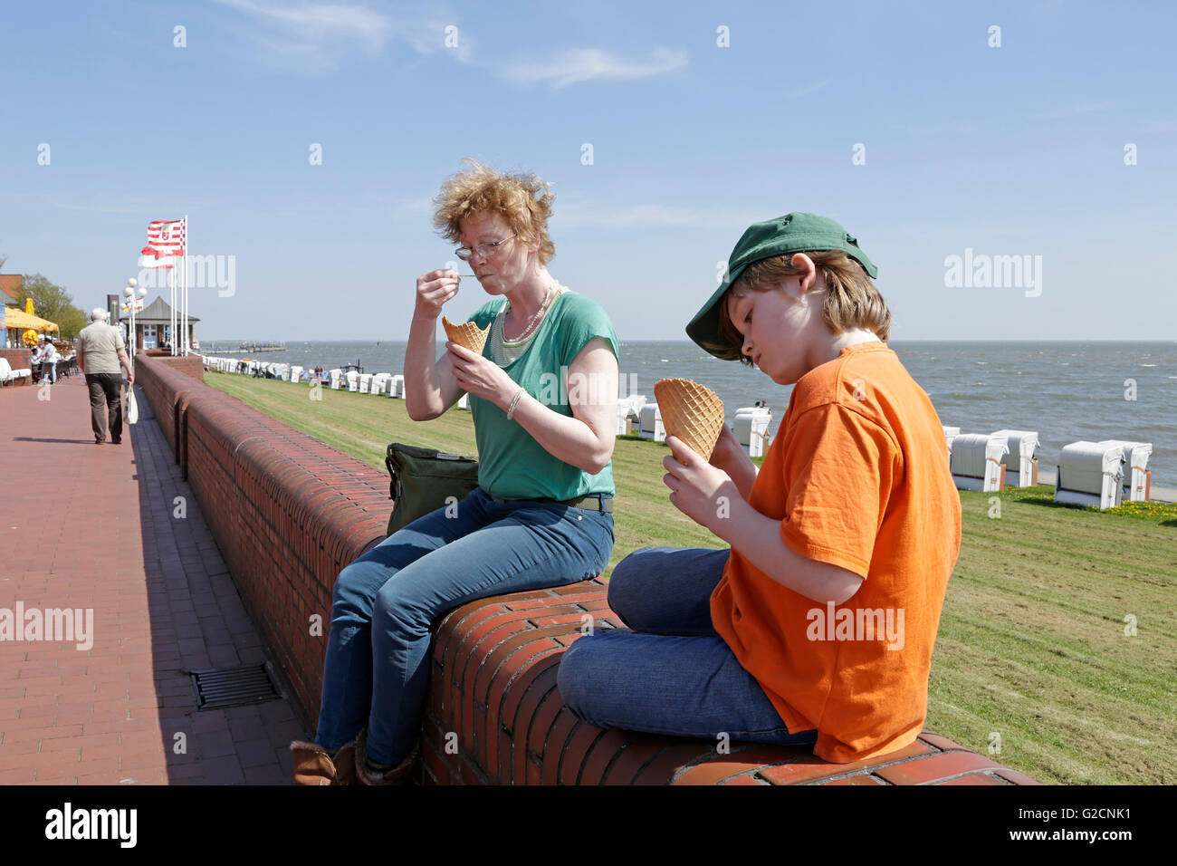 mother and son eating ice cream, seafront, South Beach, Wilhelmshaven, Lower Saxony, Germany - Stock Image
