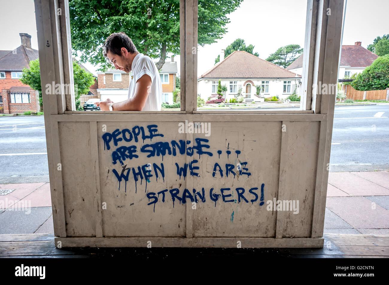Graffiti in a bus stop in Brighton. - Stock Image