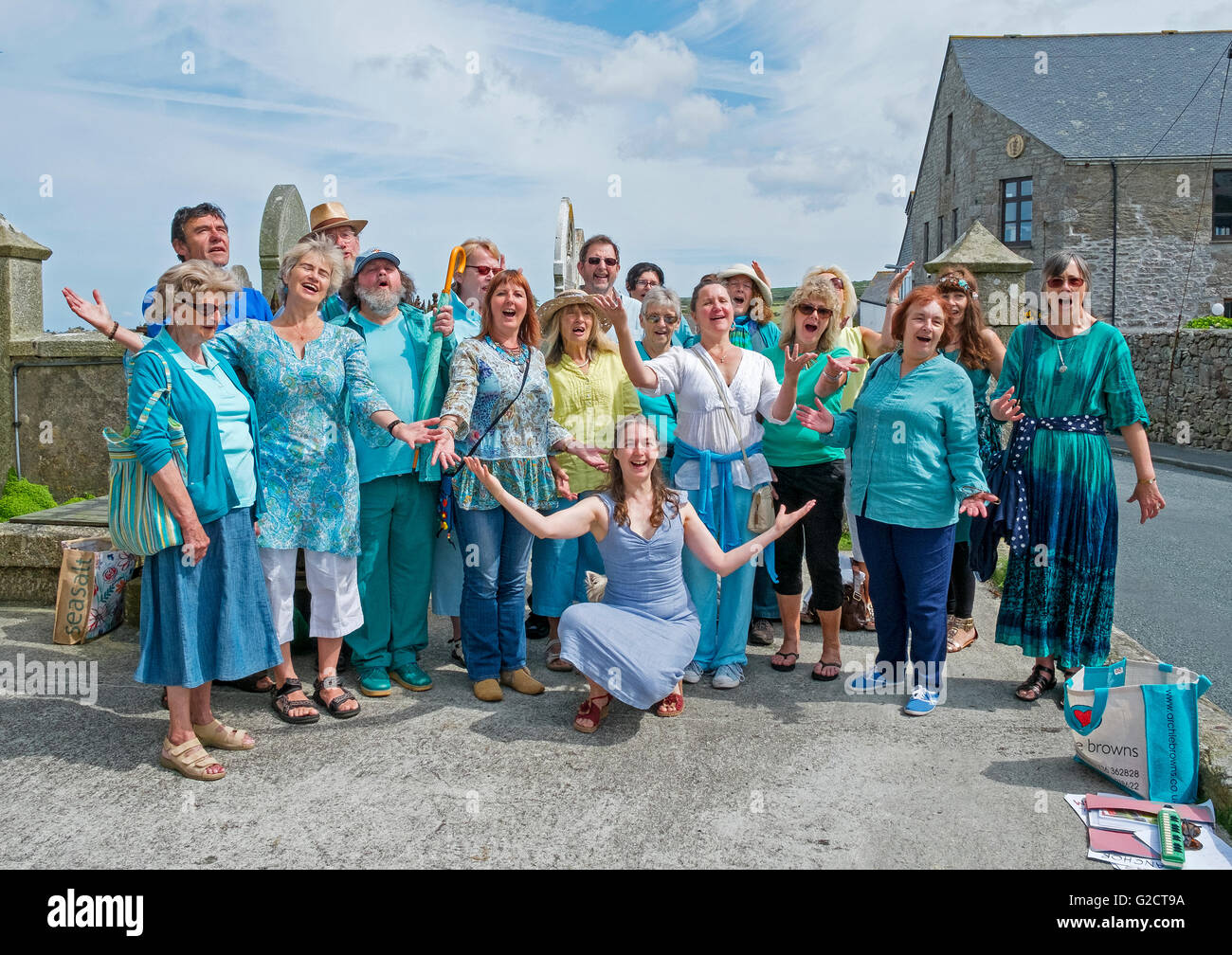 A community drama group singing in the street at St.Just in Cornwall, England, UK - Stock Image