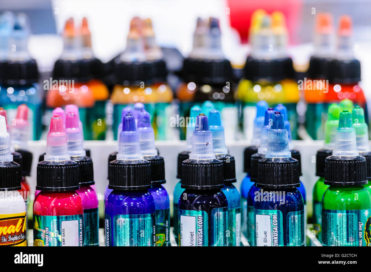 BELFAST, NORTHERN IRELAND. 28 MAY 2016 - 6th Northern Ireland Tattoo Conference. Bottles of tattoo ink on a shelf. Stock Photo