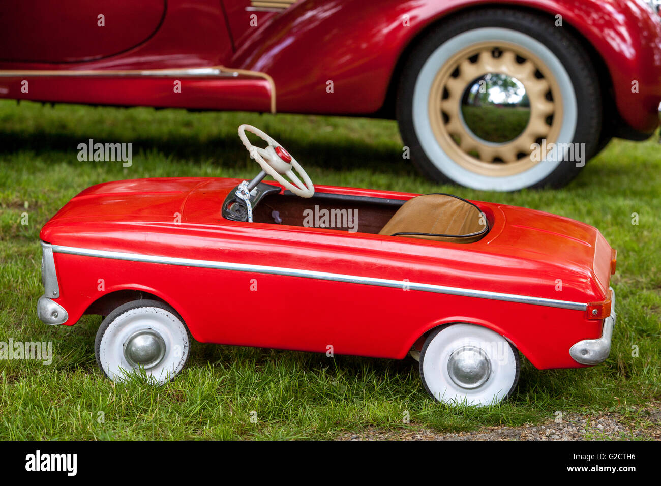 Pedal car  toy is parked, veteran cars - Stock Image