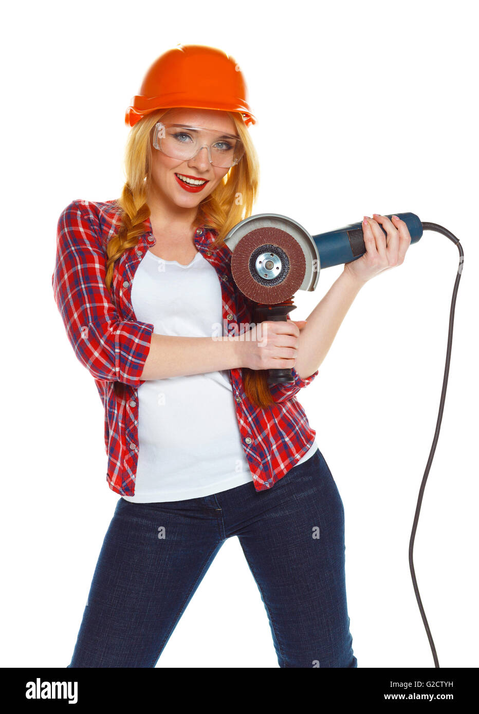 Female construction worker in a hard hat with angle grinder over white background - Stock Image