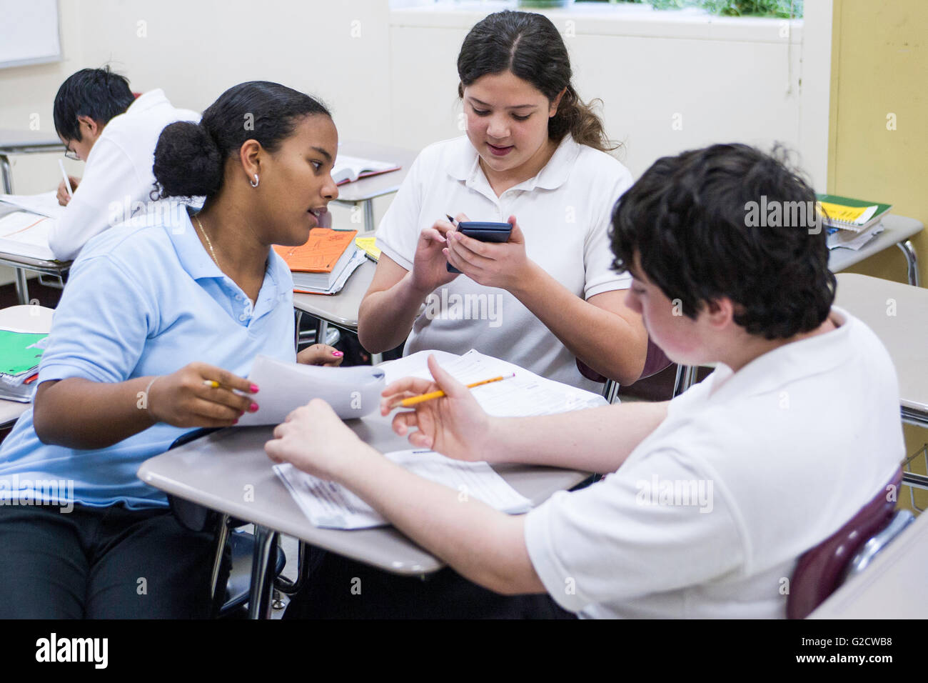 Three high school students studying together - Stock Image