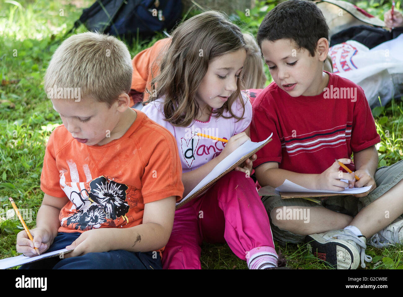 Kids studying together outside - Stock Image
