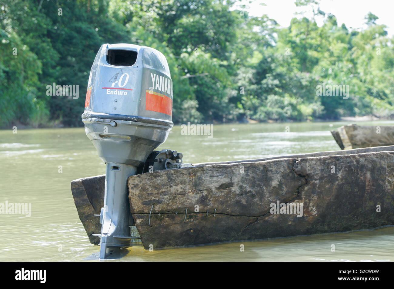 Motor canoe on the amazon river. - Stock Image