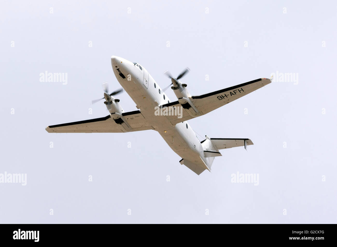 Medavia Raytheon 1900D [9H-AFH] climbing out of runway 13. - Stock Image