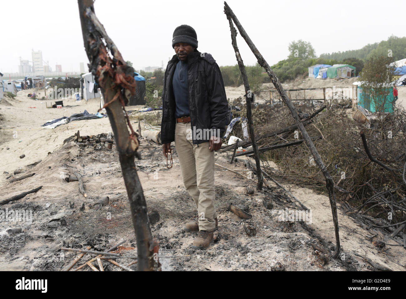 Angola a mechanical engineer from North Darfour contemplates his  home burned in clashes in the migrant camp dubbed Stock Photo