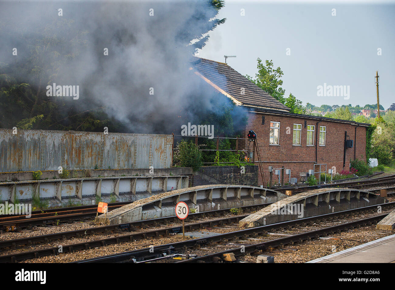 Salisbury, UK. 28th May, 2016. The fire alongside the tracks at Salisbury Station which delayed  the Flying Scotsmans Stock Photo