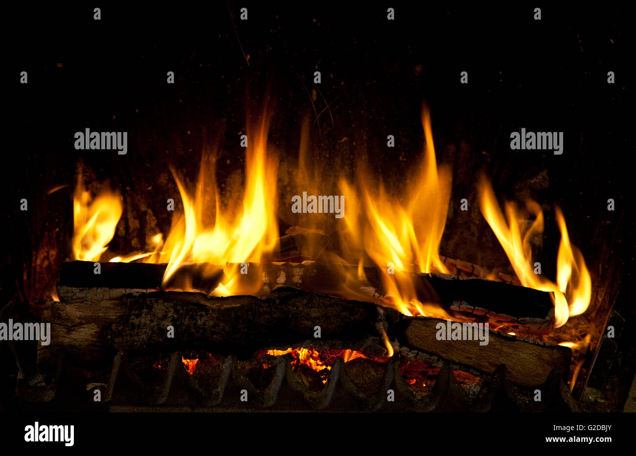 Burning And Glowing Pieces Of Wood In Fireplace Stock Photo