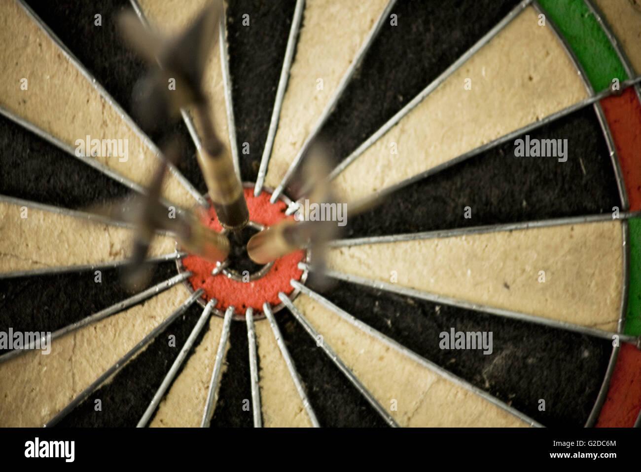 three darts in bullseye of dart board stock photo 104786492 alamy
