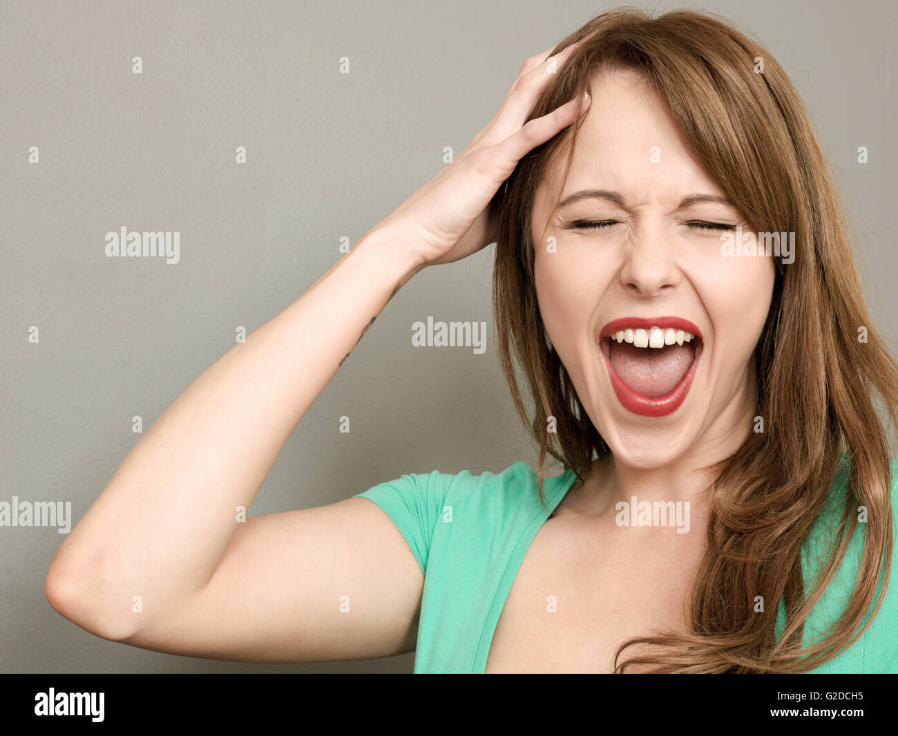 Portrait of a Frustrated Angry Woman Screaming in a Temper or Tantrum - Stock Image