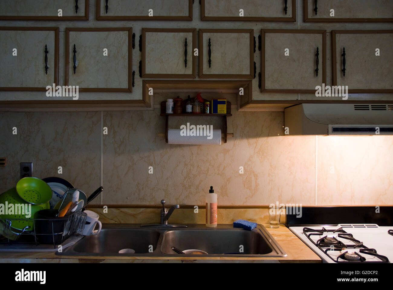Retro Kitchen, Close-up of Sink, Stove, Counter and Cabinets - Stock Image