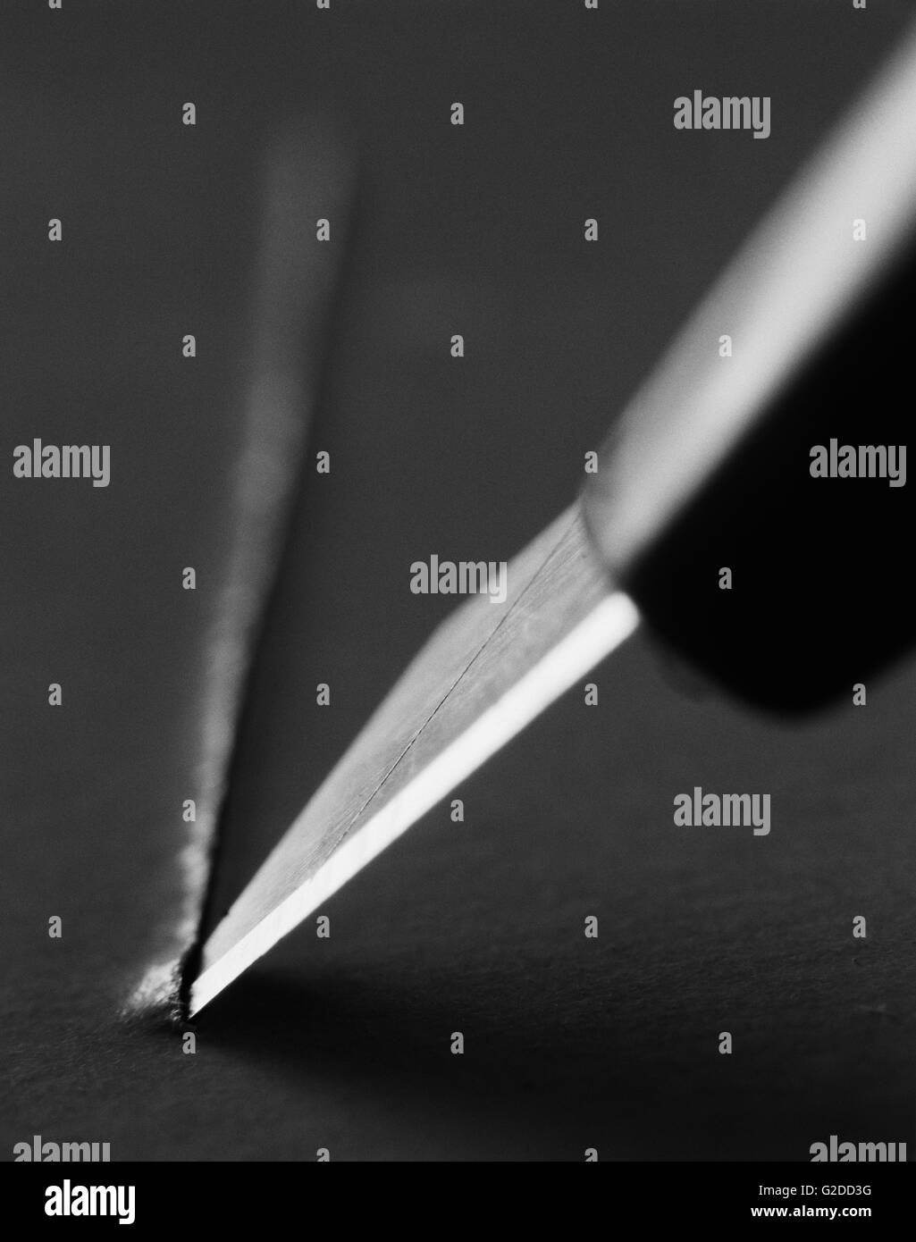 Sharp Knife and Paper - Stock Image