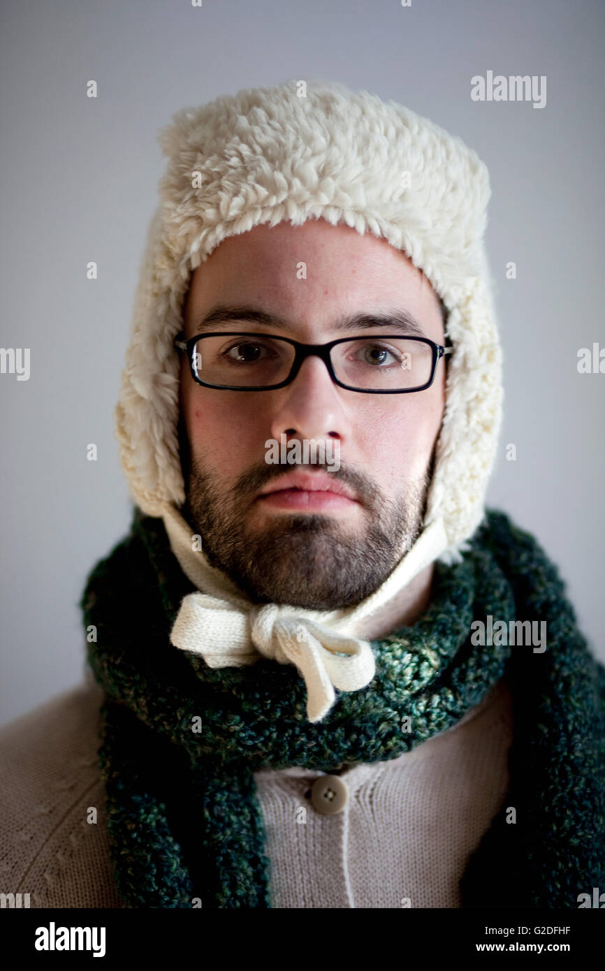 Man with Beard and Eyeglasses Wearing Hat and Scarf, Portrait, Close-Up, - Stock Image