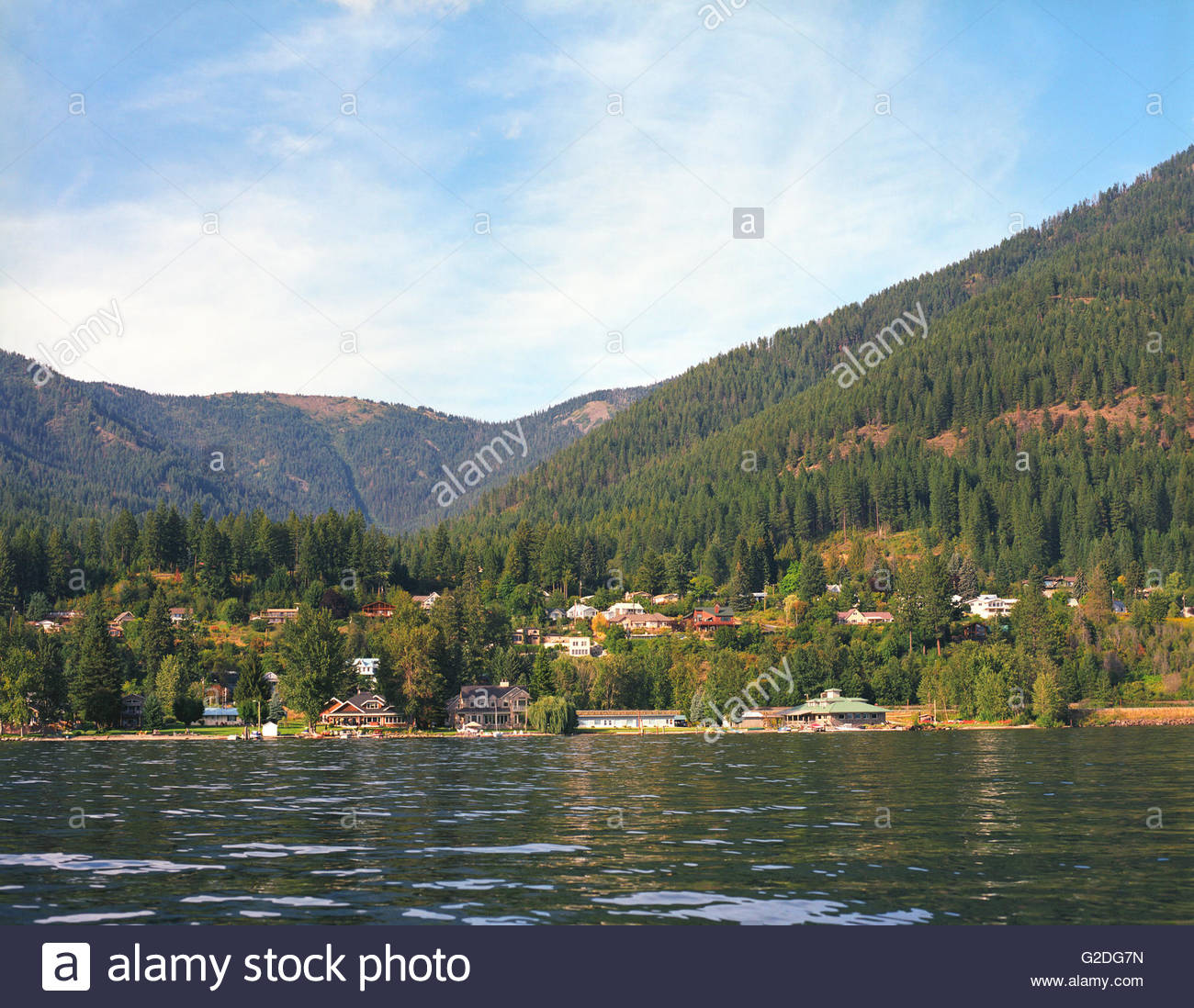 Lakeside Town and Mountains - Stock Image
