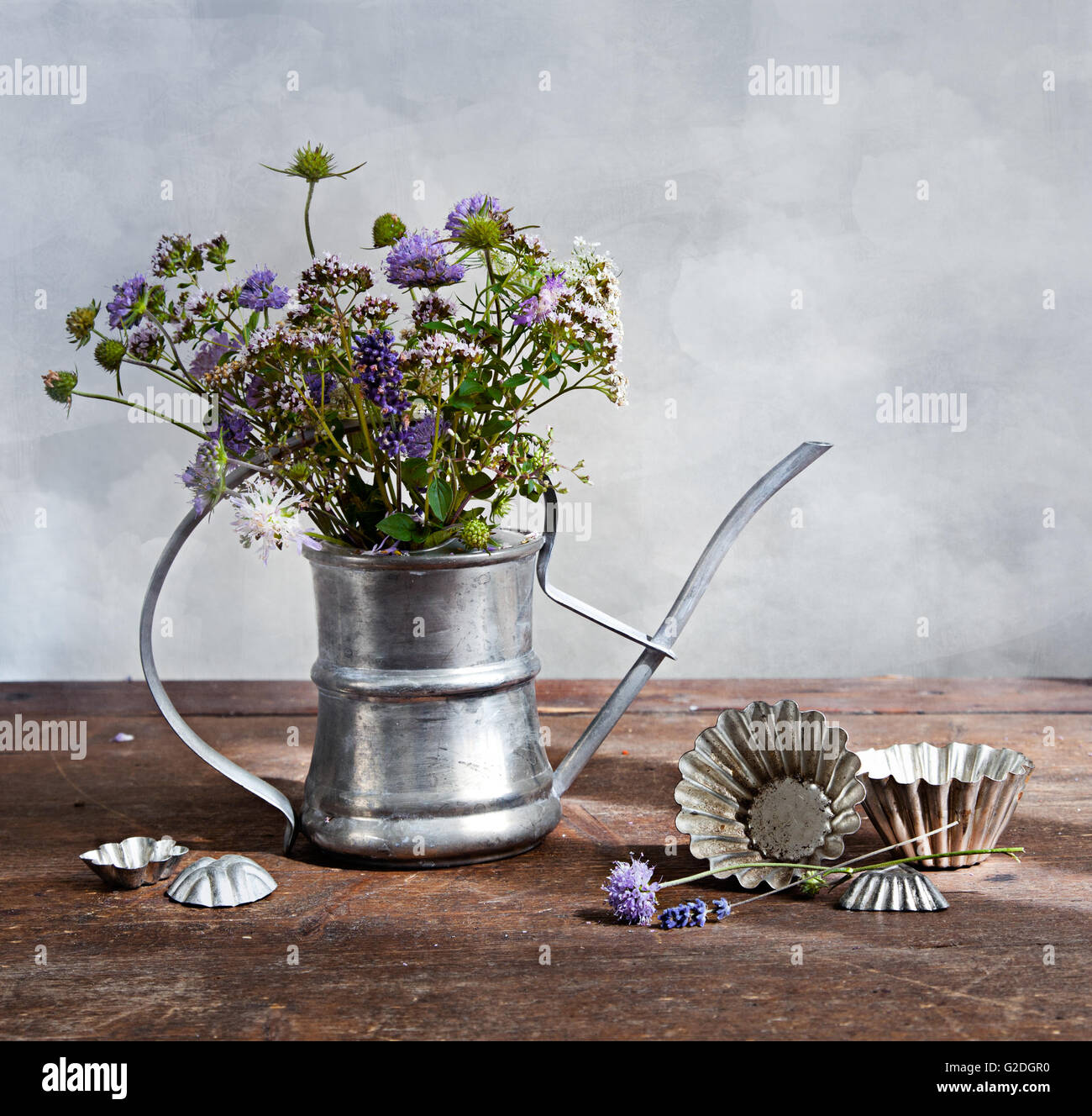 Bouquet of wild flowers in old metal ewer Stock Photo