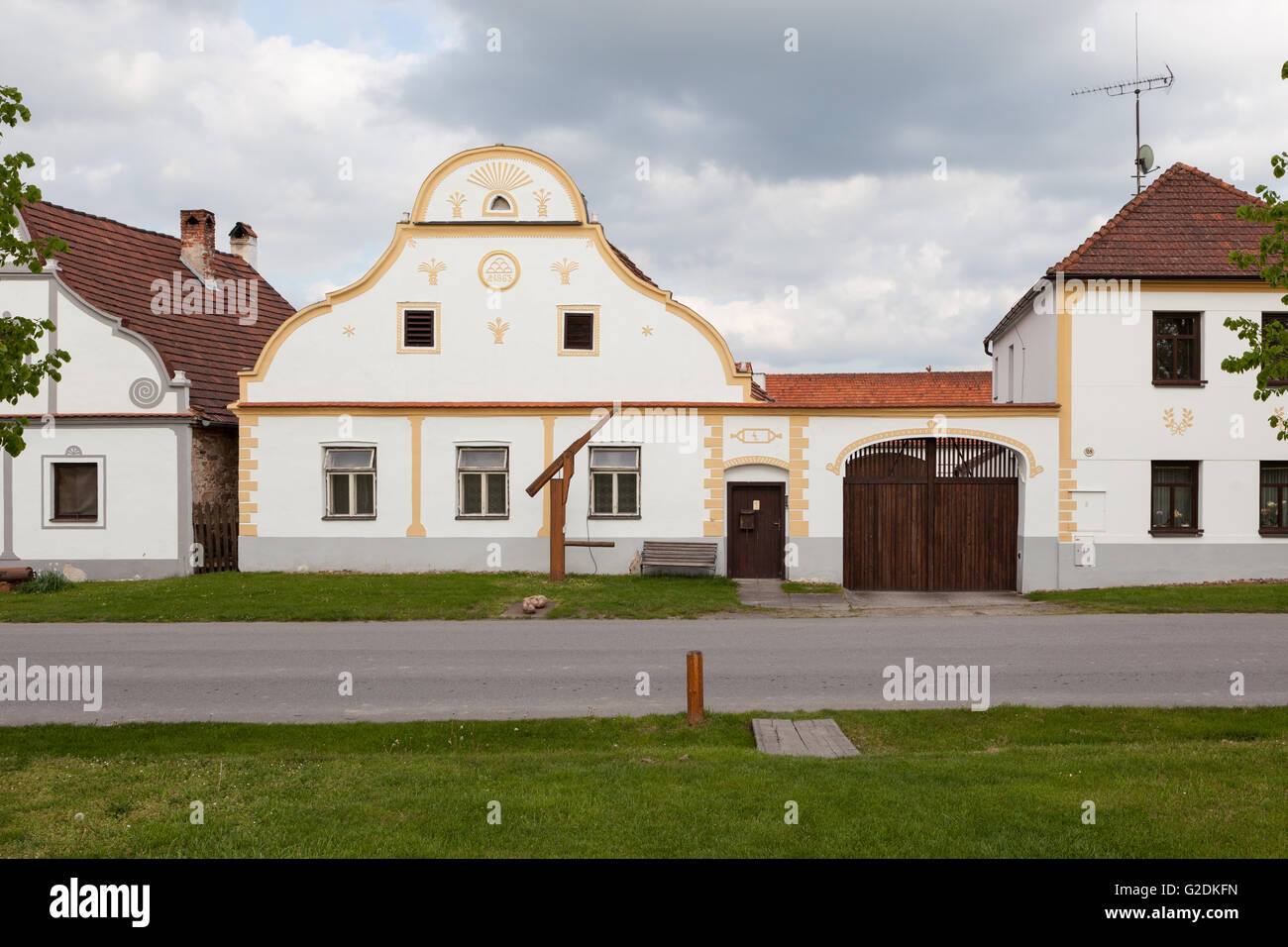 Facades of houses at historical village of Holasovice - Stock Image