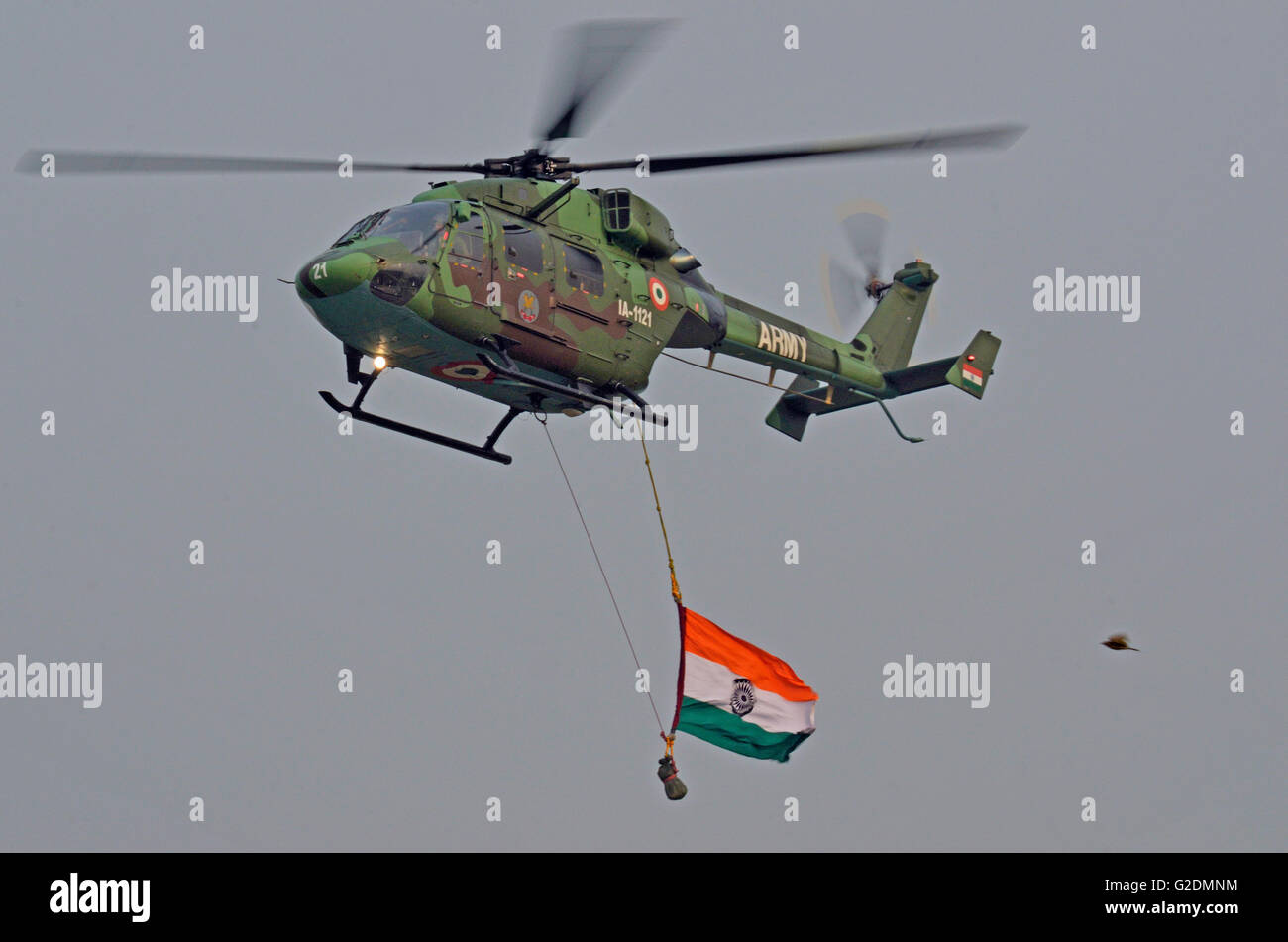 Dhruv - Advanced Light Helicopter, designed and manufactured by Hindustan Aeronautics Limited, flying past on Army - Stock Image