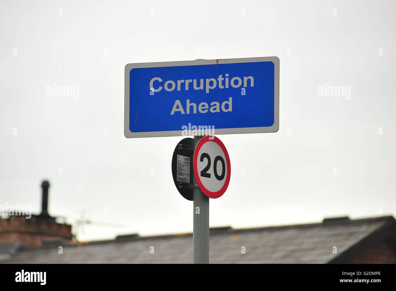 Corruption Ahead on a sign in Bristol in the UK. - Stock Image