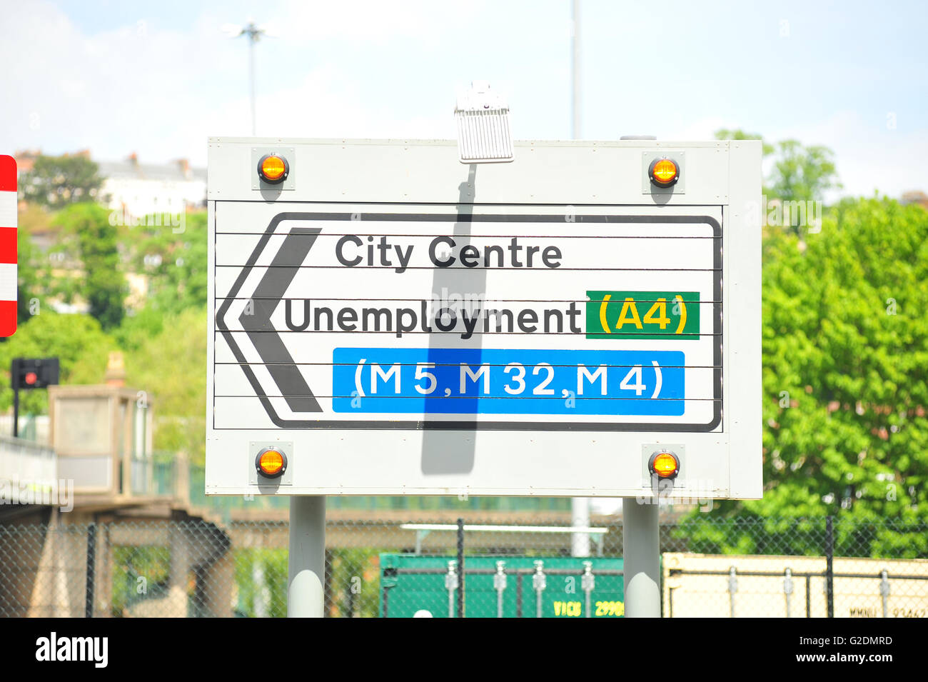 A City Centre road sign with Unemployment written on it. - Stock Image