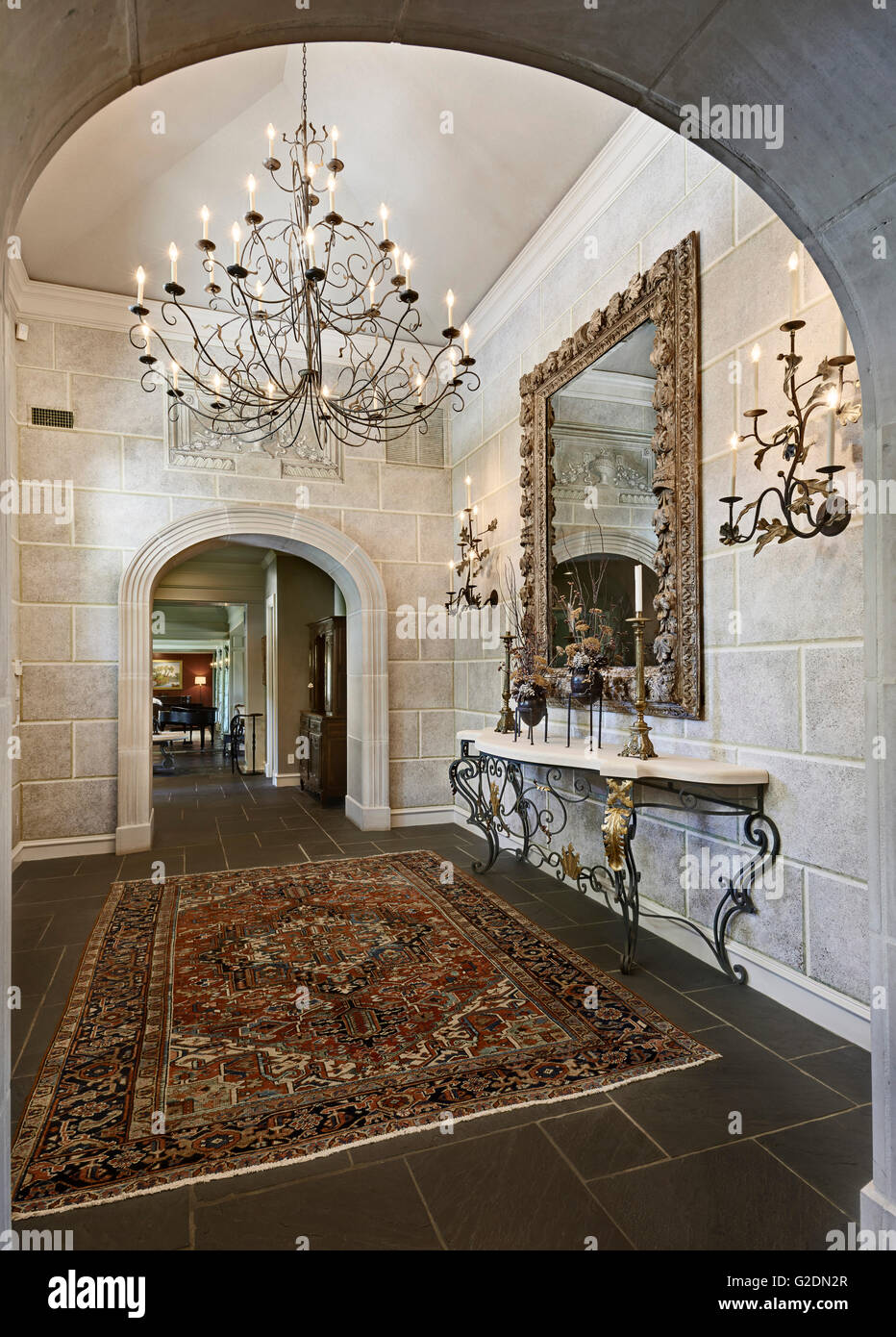 Foyer of Affluent House with Large Chandelier - Stock Image