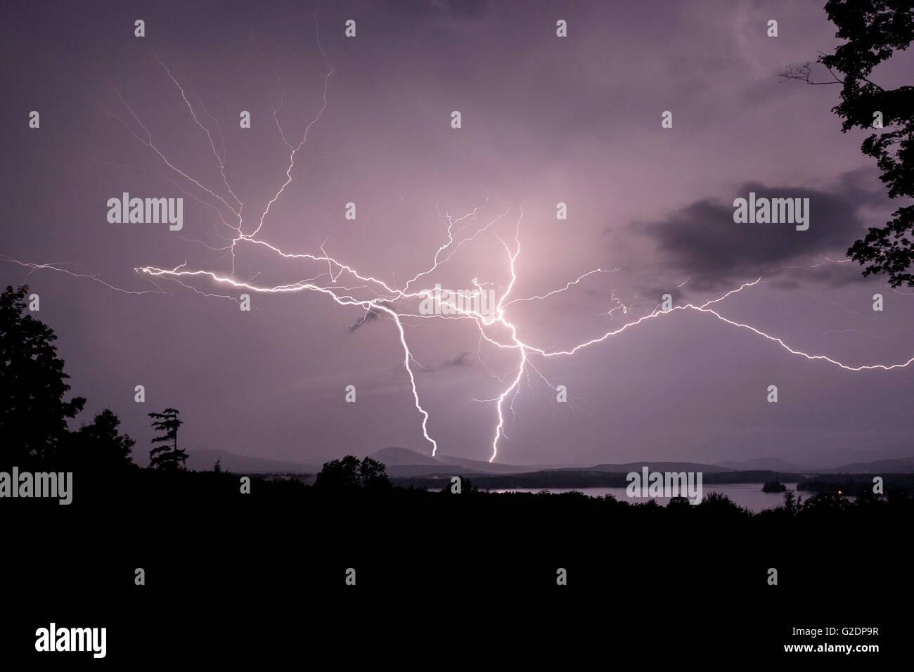 Lightening strike over Sacandaga Lake, Adirondack Mountains, Lake Pleasant, New York, United States - Stock Image