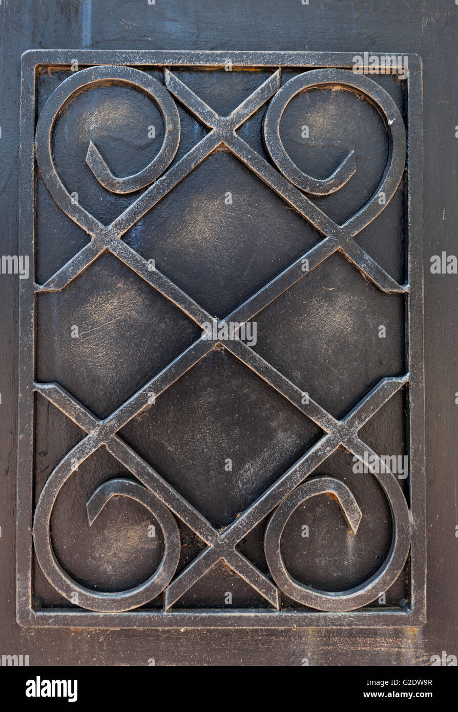 old metal ornament on entrance gate rusty and diry - Stock Image