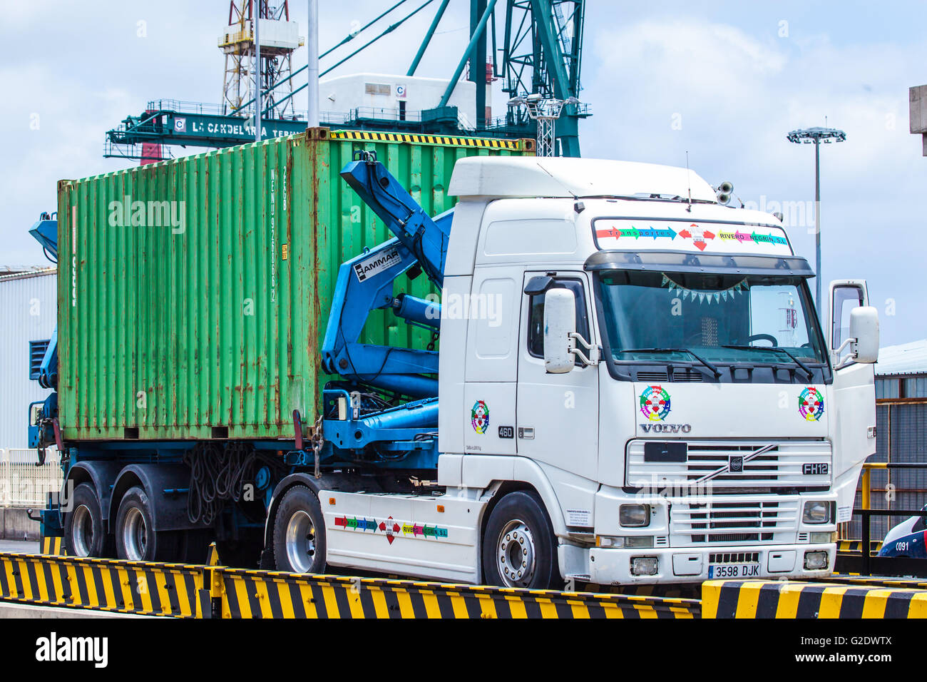 truck with container parked in a dock - Stock Image
