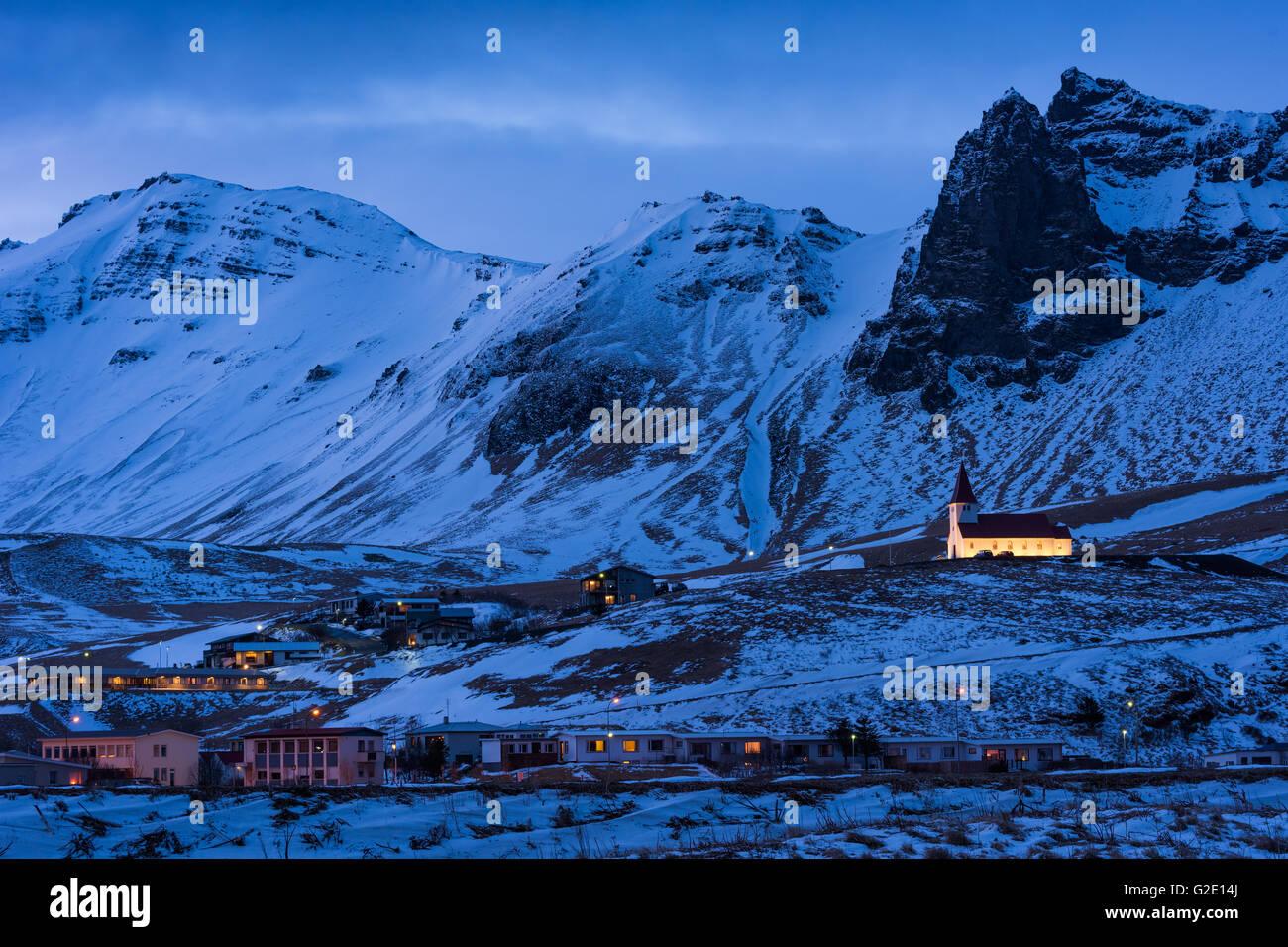 Blue Hour, Mountains, Church, Vík í Mýrdal, Myrdal, Southern Region, Iceland - Stock Image