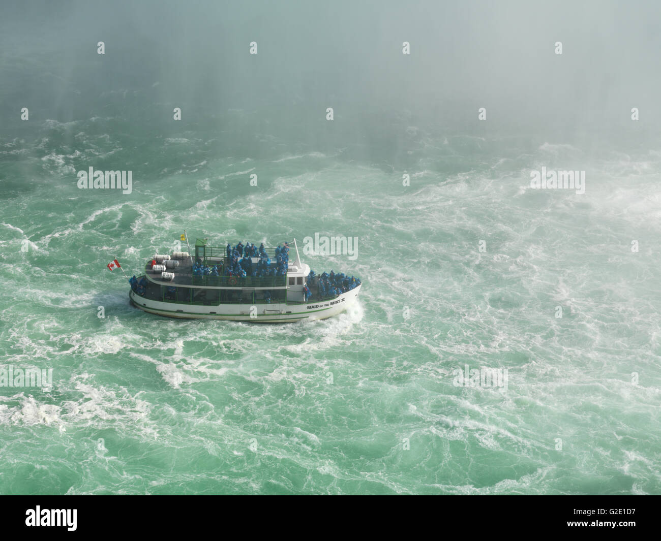 People on the tour boat 'Maid of the Mist' approaching the Niagara Falls, Niagara Falls, Ontario Province, - Stock Image