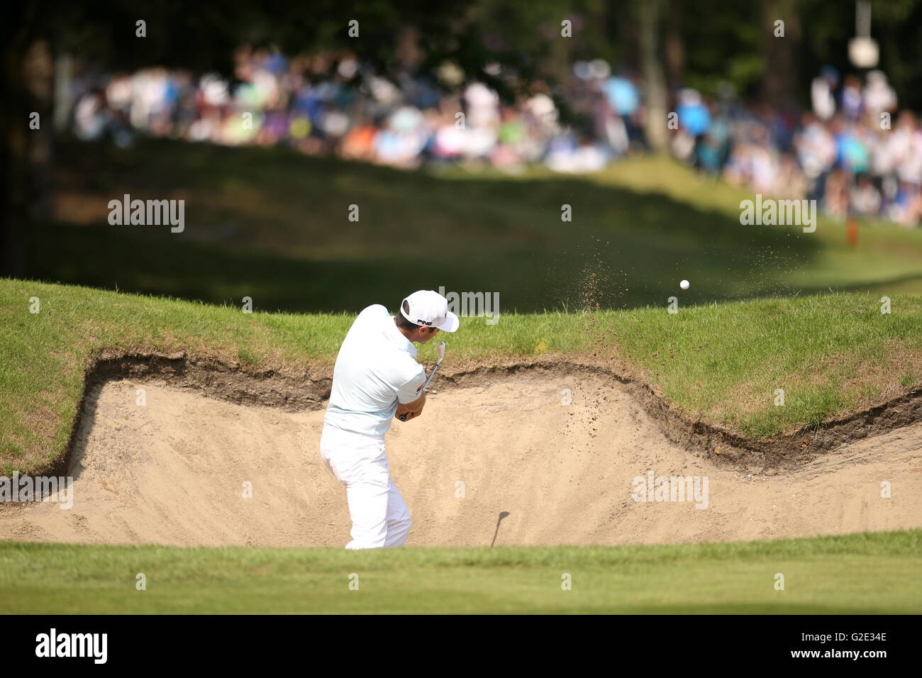 France's Julien Quesne plays a bunker shot on the 13th hole during day four of the BMW PGA Championship at Wentworth - Stock Image